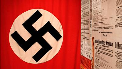 Oklahoma woman shot multiple times after tearing down Nazi flag outside man's home