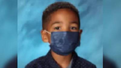 'I always listen to my mom': 1st-grader keeps mask on for school photo