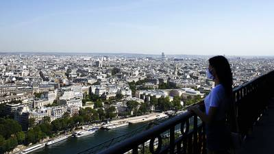 Photos: Eiffel Tower reopens after coronavirus shutdown
